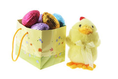 Toy Chick and Shopping Bag with Easter Eggs Royalty Free Stock Photography