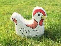 Toy chicken in a feild Stock Photos
