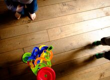 Toy and children's feet on floor Royalty Free Stock Photos