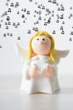 Toy Christmas angel with a book singing background music Stock Images