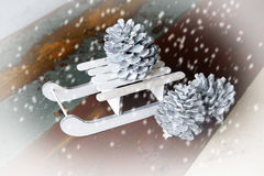 Toy christmas sleigh with pinecones Stock Images