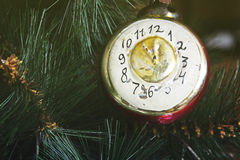Toy on the Christmas tree - the old clock Royalty Free Stock Image