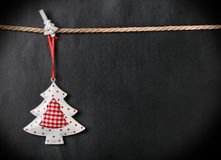 Toy Christmas tree and place for text. On a black background Royalty Free Stock Image