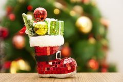 Toy on the Christmas tree with shoes. Royalty Free Stock Image