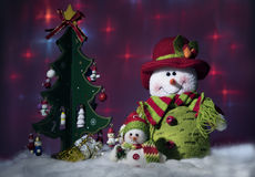 Toy Christmas tree and snowmen. Holiday scene: toy Christmas tree and snowmen Stock Image