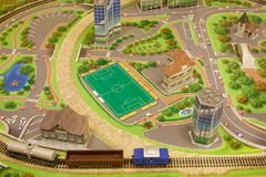 Toy city with a railway and a freight train. Carefree childhood Stock Image