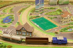 Toy city with a railway and a freight train. Modern transport. Carefree childhood Royalty Free Stock Photos