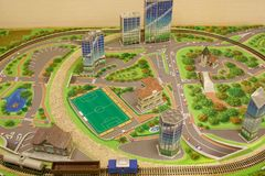 Toy city with a railway and a freight train. Modern transport. Carefree childhood Stock Photography