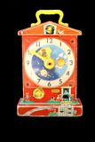 Toy Clock. Antique toy windup clock isolated in black background Royalty Free Stock Photography