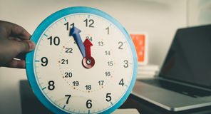 Toy clock counting to lunch time Stock Photography