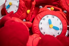 Toy clock in a toy store. Big soft toy clock in the box with toys in a toy store. shopping concept.christmas concept Stock Photos