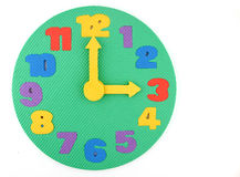 Toy Clock on white background Royalty Free Stock Image
