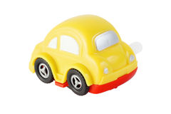 Toy clockwork automobile with silver windows. Bright toy clockwork yellow automobile with silver windows on white background Stock Images