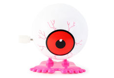 Toy clockwork white eye with pink legs Royalty Free Stock Photo