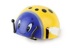 Toy clockwork yellow ladybird with blue face Stock Photo