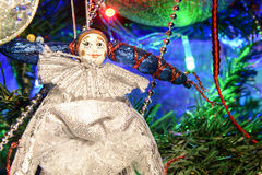 Toy clown on the Christmas tree Stock Photo