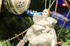Toy clown on the Christmas tree Stock Photos