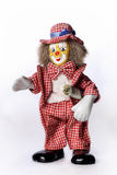 Toy clown with a dollar Royalty Free Stock Photography