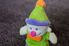 Toy clown. Green hat. Purple pants. Royalty Free Stock Images