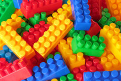 Toy color bricks background. Close-up royalty free stock image