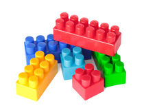 Toy color bricks on white background. Isolated stock image