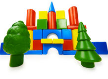 Toy colored castle and plastic trees Royalty Free Stock Images