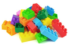 Toy colorful plastic blocks on white background Royalty Free Stock Images