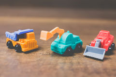 Toy construction machinery. On wooden background Royalty Free Stock Photo