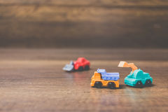 Toy construction machinery. On wooden background Stock Image