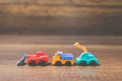 Toy construction machinery. On wooden background Stock Photo