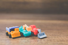 Toy construction machinery. On wooden background Stock Photography