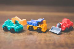 Toy construction machinery. On wooden background Royalty Free Stock Photography