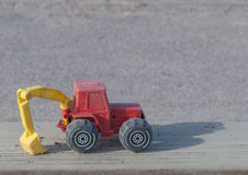 Toy construction tractor background Stock Photo