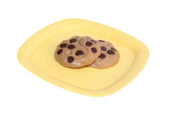 Toy Cookies. Two toy cookies on a yellow dish Stock Photos