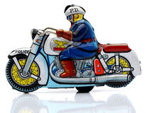 Toy cop. On a motorcyckle Royalty Free Stock Photography