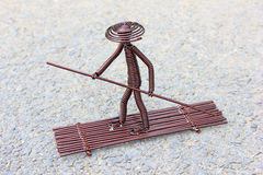 Toy crafts boatman made of copper wire Royalty Free Stock Photos