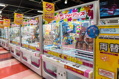 Toy crane game vending machine. Tokyo, Japan - April 12, 2016: Toy crane game vending machine at game center in Tokyo. Japan Royalty Free Stock Photo