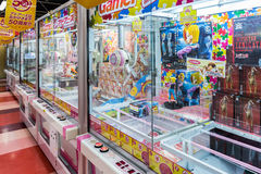 Toy crane game vending machine. Tokyo, Japan - April 12, 2016: Toy crane game vending machine at game center in Tokyo. Japan Stock Photo