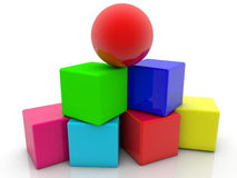 Toy cubes assembled in pyramid with red ball on the top Royalty Free Stock Photography