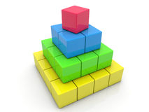 Toy cubes assembled in pyramid on white Royalty Free Stock Photo