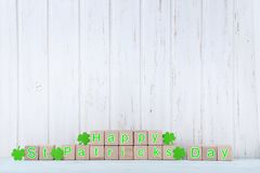 Toy cubes and green clover leafs royalty free stock images