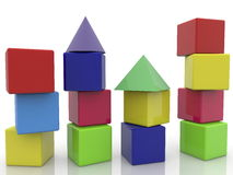 Toy cubes with roofs stacked on white Royalty Free Stock Photography