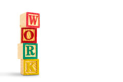 Toy cubes are used to create the word work. Wooden toy cubes are used to create the word work Royalty Free Stock Images