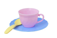 Toy cup, saucer and spoon. Plastic Stock Photography