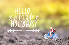 Toy cyclist ecotourism concept. A toy cyclist is taking a ride. Ecotourism concept Royalty Free Stock Photo