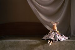 The toy dancer sits at the `scene`. Self-made toy deer. Dressed in dancer clothes royalty free stock photos