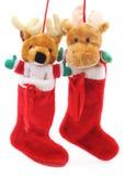 Toy deer in Сhristmas socks. Stock Photos