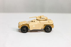 Toy desert tan Armored Personnel Carrier. A toy desert tan Armored Personnel Carrier stock photo