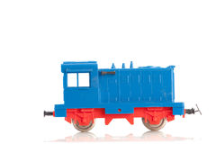 Toy diesel locomotive on white. Pictured items of a toy railroad Royalty Free Stock Photo
