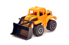 Toy digger. Yellow toy digger over a white background with soft shadow Stock Photos